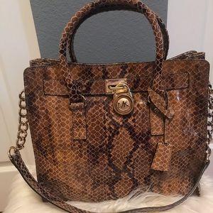 3e16a30c710 Michael Kors. Michael Kors Hamilton Python print large handbag